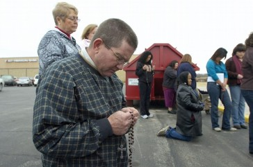 Kneeling outside Abortion Clinic